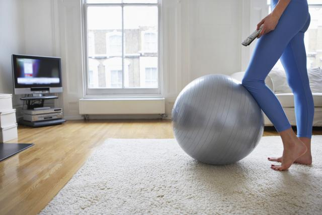 Woman Exercising with Television - mashupcorner